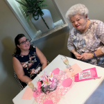 Our new resident Anna Mae and her daughter in law, loving the pink theme at our social.